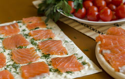Slices of fresh salmon on a piece of pita. Cooking Royalty Free Stock Photography