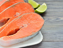 Slices of fresh salmon on a plate Stock Photo