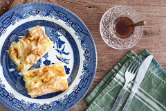 Slices of fresh Turkish borek served with tea Royalty Free Stock Photo