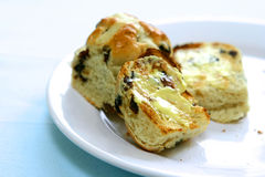 Slices of freshly toasted hot cross buns Stock Image