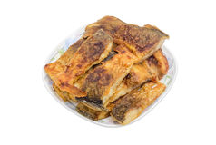 Slices of a fried fish on a white dish Royalty Free Stock Photo