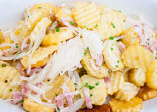 Slices fried potatoes. With ham and onion slices Stock Images