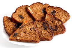 Slices of fruit bread lie on a plate. Isolated on a white background Royalty Free Stock Photography
