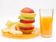 Slices of fruit and juice. Slices of apples, banana on a plate and juice Royalty Free Stock Photography