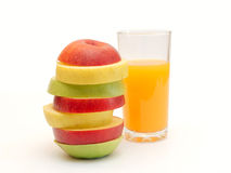 Slices of fruit and juice. Slices of apples and yellow juice in a glass Stock Photo