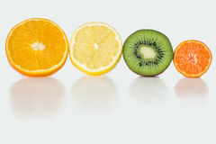 Slices of Fruit on White Background. Vitamins royalty free stock images