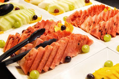 Slices of fruits for dessert. Fruits on plates for dessert Royalty Free Stock Image