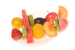 Slices of fruits on plate Stock Image
