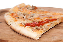 Slices of funghi pizza with tomato ketchup on the wooden board Royalty Free Stock Photography