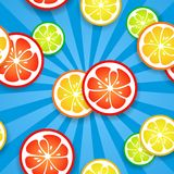 Slices of funny fresh citrus fruits on blue beams Royalty Free Stock Photography