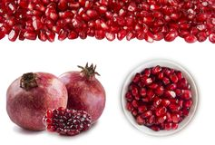 Slices of garnets, two garnet fruit and heap of pomegranate seeds at the border. Set of pomegranates. Pomegranates isolated on whi. Te background. Top view stock photos