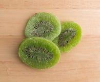 Slices of glazed kiwi fruit on a cutting board Royalty Free Stock Photos