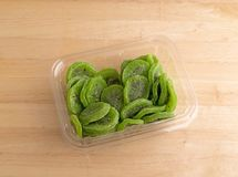 Slices of glazed kiwi fruit in a plastic container Royalty Free Stock Image