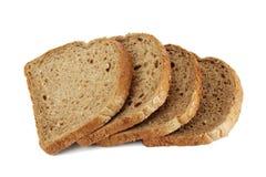 Slices of grain brown bread Royalty Free Stock Photos
