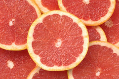 Slices Grapefruit. Fresh slices Grapefruit background. Close-up Royalty Free Stock Image