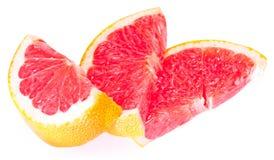 Slices of grapefruit. Isolated on white background Stock Photo