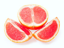 Slices of grapefruit. Isolated on white background Royalty Free Stock Image