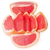 Slices of grapefruit. Isolated on white background Royalty Free Stock Photos