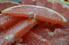 Slices of grapefruit. Delicious grapefruit slices in sugar Royalty Free Stock Photos