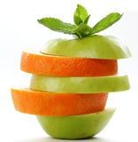 Slices green apple and orange Stock Photo