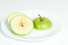 Slices of green apple in a  plate. Slices of green apple in a white plate Stock Images
