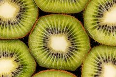 Slices of green kiwi face up. Stock Photos