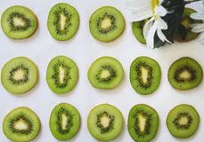 Green slices of Kiwi fruit on white background. Slices green kiwi fruit white background closeup pattern dessert  diet fresh freshness healthy juicy nature royalty free stock image