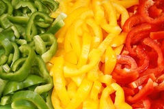 Slices of green, yellow and red bell pepper. Organic background made of slices of green, yellow and red bell pepper. Organic flag of Mali royalty free stock photography