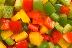 Slices of green, yellow and red bell pepper Royalty Free Stock Images