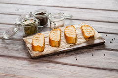 Slices of grilled baguette. Royalty Free Stock Images