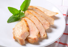 Slices of grilled chicken breast Stock Photos