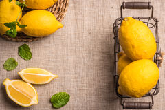Slices, half fresh juicy lemon with mint leaves. Top view with copy space. Royalty Free Stock Photo