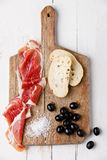 Slices of ham, Black olives and ciabatta Royalty Free Stock Photography