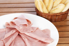 Slices of ham and bread Stock Photography