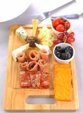 Slices of ham and cheese. On wood plate stock photo