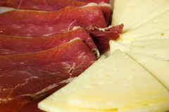 Slices of ham and manchego cheese. Closeup of some slices of serrano ham and manchego cheese Royalty Free Stock Photos