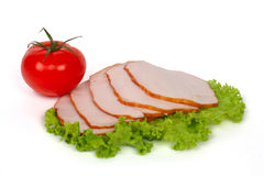 Slices of ham and one tomato royalty free stock images
