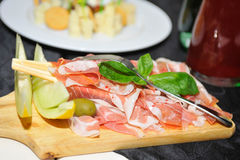 Slices of ham on plate Stock Images