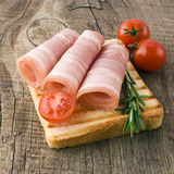 Slices of ham with rosemary Royalty Free Stock Image