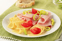 Slices of ham and Swiss cheese Stock Photos