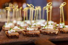 Slices of herring lay on   black bread. Royalty Free Stock Photos