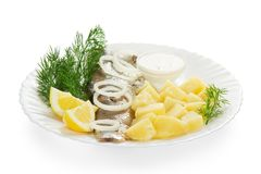 Slices of a herring and potato, the onions rings Stock Photos