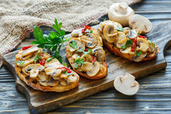 Crostini with grilled mushrooms and onions. Royalty Free Stock Image