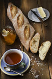 Slices of homemade fresh baguette, plate with cheese, jar of nat Royalty Free Stock Photos