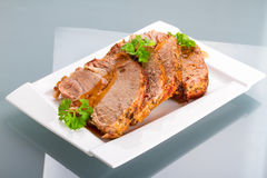 Slices of homemade roast pork with reflection Stock Photos