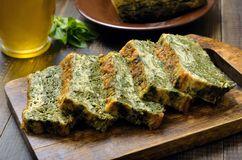 Slices of homemade spinach bread. On wooden cutting board, close up Royalty Free Stock Photography
