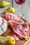Slices of italian ham on the wooden board Royalty Free Stock Images