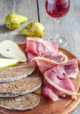 Slices of italian ham on the wooden board Stock Image