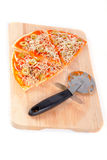 Slices of Italian pizza and cutter Royalty Free Stock Image