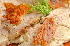 Slices of italian porchetta with fresh rosemary Royalty Free Stock Photo